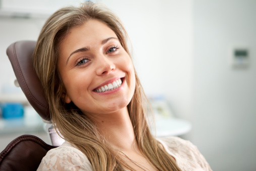 Woman smiling after getting inlays and onlays at South Austin Dental in Austin, TX