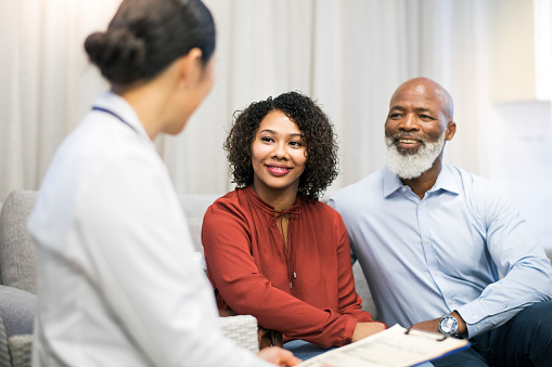 Older Black couple speaking with our doctor about same day dentures at South Austin Dental in Austin, TX