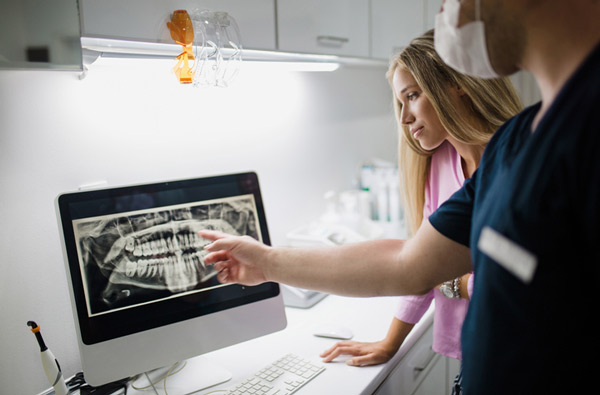 Dentist reviewing a digital x-ray with patient at South Austin Dental in Austin, TX